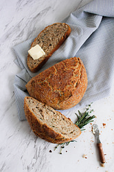 rosemary bread loaf with butter