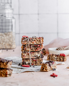 Strawberry Banana granola bars stacked and tied with a bow