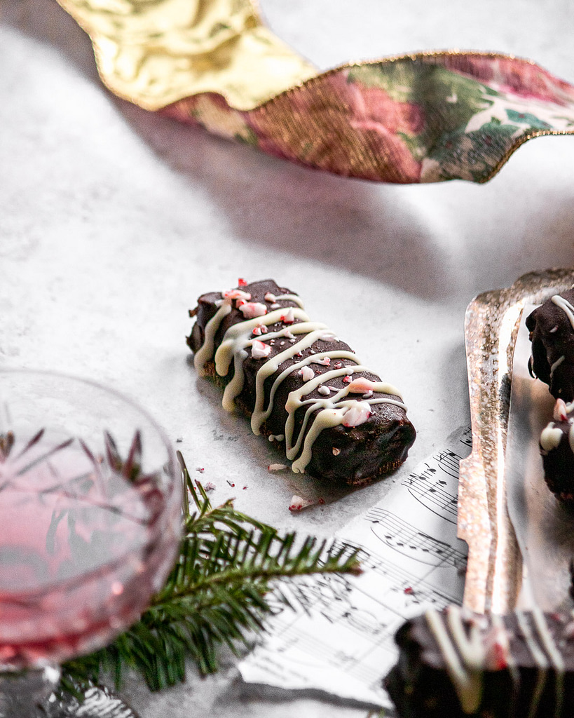 close up of a twix bar with wine and festive decor
