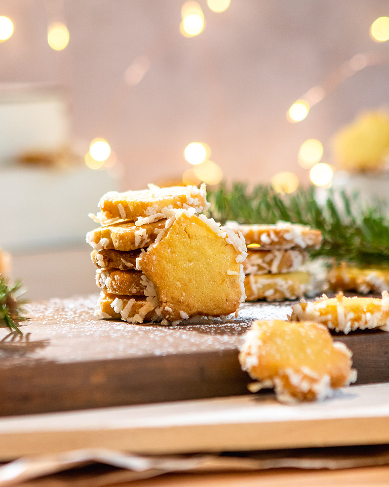 star cookies stacked in front of a lit background
