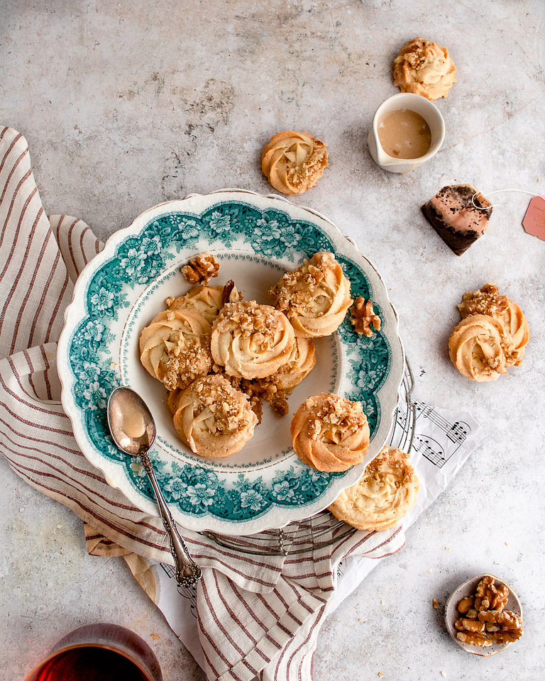 Butter swirl shaped cookies on a vintage green plate.