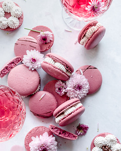 red wine macarons with purple flowers