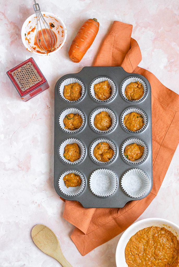 a muffin pan waiting to be baked