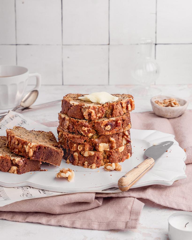 a stack of fresh banana bread with butter