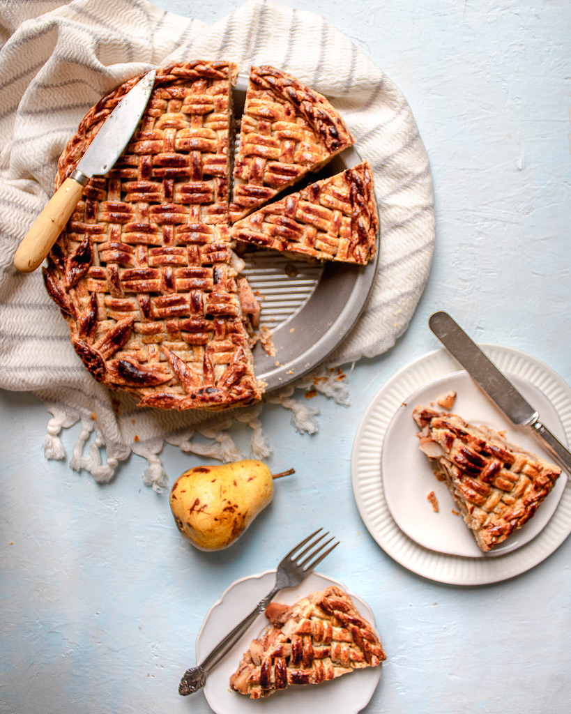 Cut pear pie slices served on two plates
