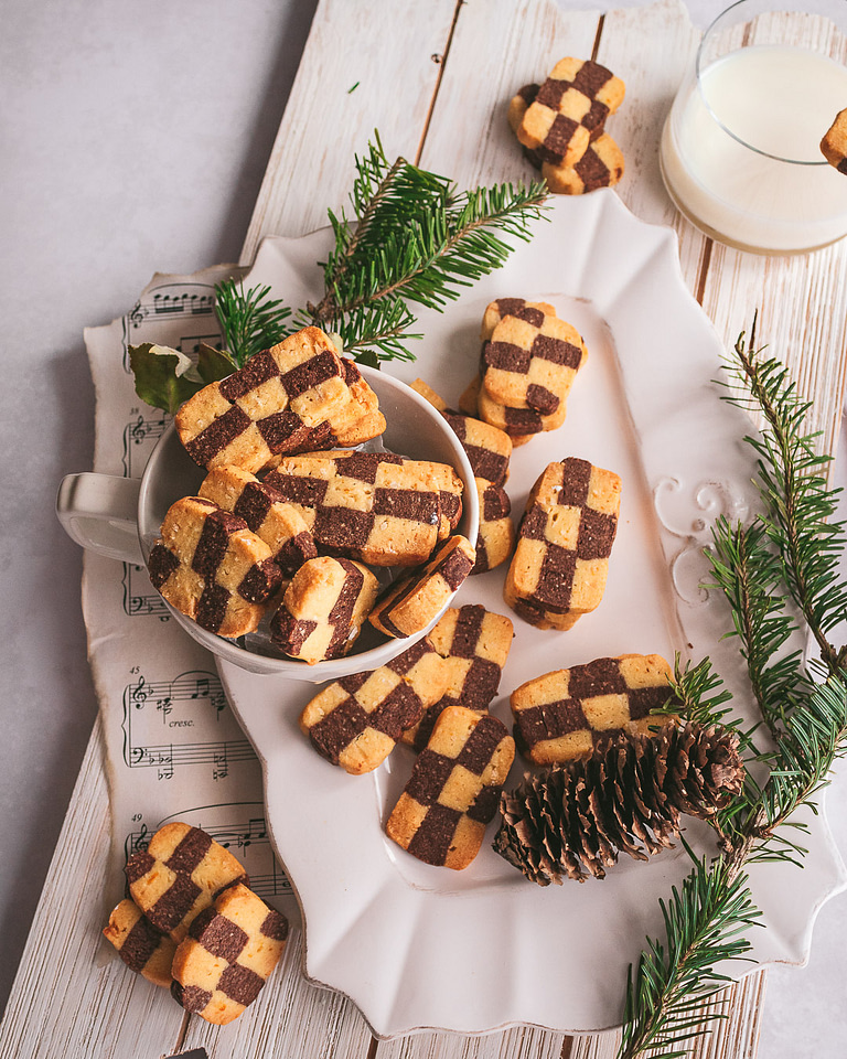 chocolate orange coconut checkerboard cookies on a white platter
