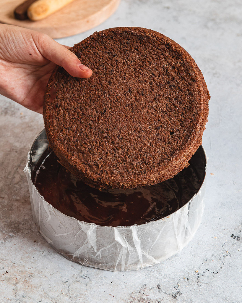 adding the chocolate sponge into the ring mould