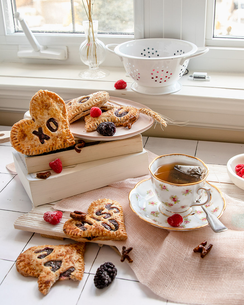 enjoying a cup of tea with berry pies