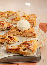 Slice of apple strudel and one topped with ice cream
